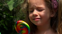 Confused Child With Candy Stock Footage
