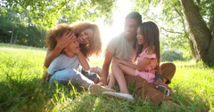 Cute brother and sister spends time with their parents. Stock Footage