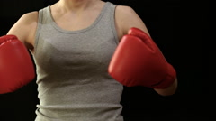Girl in boxing gloves - stock footage