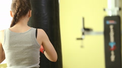 Girl in boxing pear - stock footage