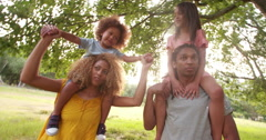 Lovely African-american family laughing and making silly faces Stock Footage