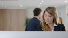 4K Attractive cheerful office colleagues looking at computer & discussing work - stock footage