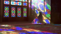 Young Muslim woman praying in Nasir Al-Mulk Mosque (Pink Mosque), Iran, Shiraz Stock Footage