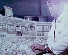 Man Operating Panel At Power Generation Plant (Archival Footage 1970/80s) - stock footage