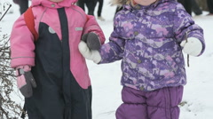 Little brother and sister holding hands in winter Stock Footage