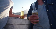 Close up view on male hands holding a bottled drink - stock footage