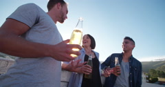 Rooftop party over the city with friends at sunset Stock Footage