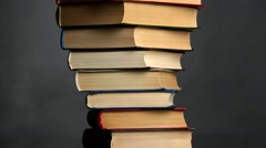Pile of books on a black background Stock Footage
