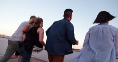 After work rooftop party for young adult hipster friends Stock Footage