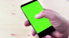 Man hands using a smart phone for write text messaging with chroma key Stock Footage