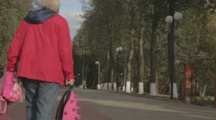 Grandfather and grandson walk in the park Arkistovideo