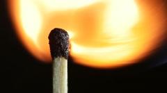 Match lighting burning.  Macro shot on black background. Slow motion. - stock footage