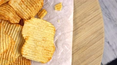Potato Chips (rippled, seamless loopable 4K footage) - stock footage