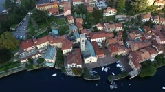 Aerial Video of a Beautiful Chapel in a Small Italian Town With a Pier and Stock Footage