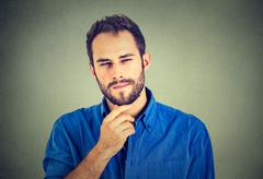 Suspicious skeptical man - stock photo