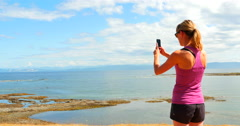 4K Woman Mobile Phone Panoramic Wide Picture, West Coast Ocean Stock Footage