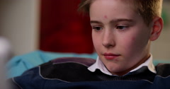4k, Young boy engrossed in playing games on a touchscreen tablet. Slow motion. - stock footage