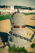 Stub posts linked in a chain on a quay - stock photo