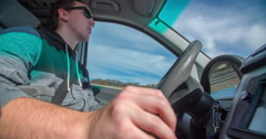 Driving a car and changing from the fifth to the fourth gear - stock footage