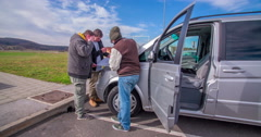 Guys have stopped in a motorway lay-by to check directions on a map Stock Footage