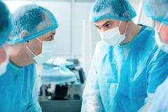 Experienced surgical doctors are saving the lives - stock photo