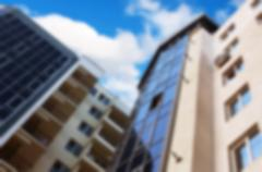 abstract unfocused apartment building view - stock photo