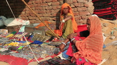 Indian women sells gadgetry on the streets of Pushkar,India. Stock Footage