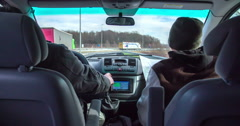 A driver is showing something to the guy sitting in the passanger seat Stock Footage