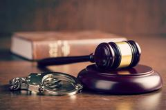 Judge gavel and handcuffs Stock Photos