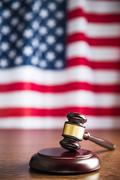 Stock Photo of judge gavel and background with usa flag