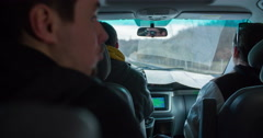Three guys driving together on highway Stock Footage