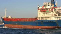 Tracking Shot Cargo Ship sailing along Bosphorus waters Stock Footage