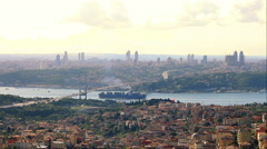 Container ship passing under Bosporus Bridge towards Marmara Sea Stock Footage