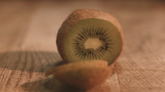 Kiwi Cut Into Slices With a Knife, Close up Stock Footage