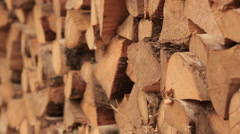 Stack of wood full of chopped firewood. Shallow depth of field. Stock Footage