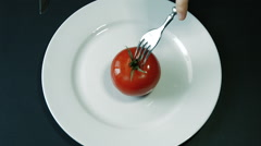 Cut Tomatoes Into Two Parts With a Knife and Fork Stock Footage