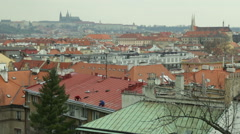 Panorama in Prague from Vysehrad in a cloudy weather while workers mend a roof. Stock Footage