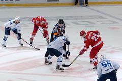 A. Kuznetsov (84) and A. Mereskin (25) on faceoff - stock photo