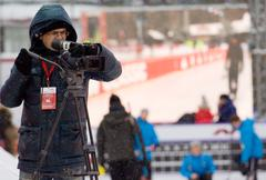 Cameraman on curling tournament - stock photo