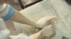 Potter preparing clay for pottering, top view. RAW video record Stock Footage