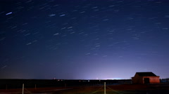 Night stars becoming rotating startrails 4k time lapse Stock Footage