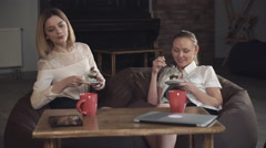 Two women eating dessert Stock Footage
