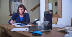 A woman is not sure about something when she's speaking on the phone Stock Footage