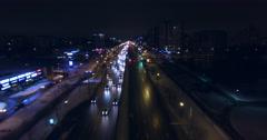 BELARUS, MINSK - Road traffic at night in city. Aerial 4K Stock Footage