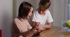 4k, Shot of a brother and sister using a digital tablet at home. Slow motion. Stock Footage