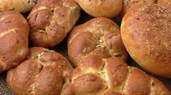 Variety of fresh bread on sacking Stock Footage