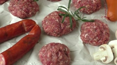 Raw minced hamburger meat with herb and spice prepared for grilling - stock footage