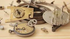 Parts of mechanical watches on a wooden surface Stock Footage