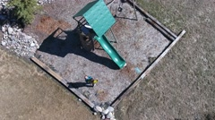 Aerial shot of family playing on a playset Stock Footage