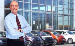 Mature Car dealer man. - stock photo